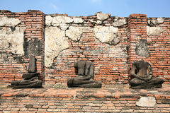 Ornament: ruined buddha statues without head. On brick wall at Maha-tad wat in Ayutthaya, Thailand Royalty Free Stock Images