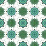 Ornament. Seamless vector pattern. Green mandalas background Stock Photos