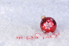 Ornament on snow with peperment candy Royalty Free Stock Photos