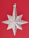 Ornament star on red Royalty Free Stock Photos