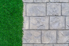 Ornament Stone footpath with pebble and grass Stock Photos