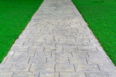 Ornament Stone footpath with pebble and grass Stock Image