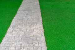 Ornament Stone footpath with pebble and grass Royalty Free Stock Photo