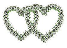 Ornament from wedding flowers. In the form of two bound hearts Stock Image