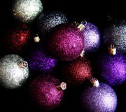 Ornament5. Pile of glitter Christmas ornaments on black background Royalty Free Stock Photography