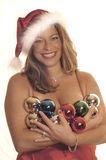Ornamental. Sexy young woman holding Christmas ornaments Stock Images