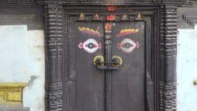 Ornamental ancient door with Buddha eyes in Katmandu stock video footage