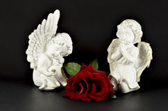 Ornamental angels with red rose for Christmas gifts Stock Images