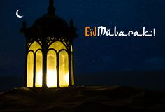 Ornamental Arabic lantern with burning candle glowing at night. Festive greeting card, invitation for Muslim holy month Ramadan stock photography
