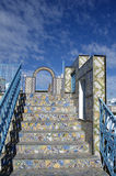 Ornamental arch and ceramic stairs on roof top terrace in Tunisia Royalty Free Stock Photos