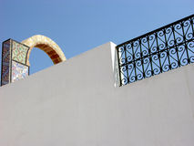 Ornamental arch on roof top terrace in Tunisia Royalty Free Stock Photo