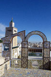 Ornamental arches on roof top terrace and mosque tower in Tunisia Royalty Free Stock Photography