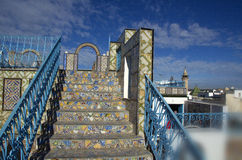 Ornamental arches and stairs on roof top terrace in Tunisia Stock Images