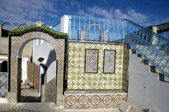 Ornamental arches and stairs on roof top terrace in Tunisia Stock Photo