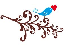 Ornamental bird with red heart Stock Photo