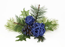Ornamental Blue Balls and Pine Cone on Green Spruce Stock Image