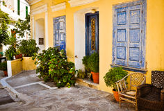 Ornamental blue doors, plants and windows, Samos, Greece Stock Photo