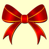 Ornamental bow. Red ornamental bow isolated over pale yellow Stock Photo