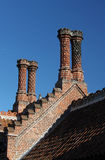 Ornamental brick chimneys Stock Photos