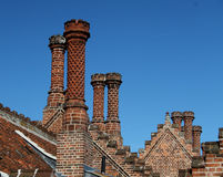 Ornamental brick chimneys Stock Photography