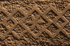 Ornamental brown plaster wall texture. Royalty Free Stock Image