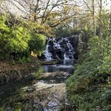 The ornamental Cascade waterfall in Virginia Water, Surrey, UK. The ornamental Cascade waterfall in Virginia Water, Surrey, United Kingdom stock images