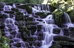 The ornamental Cascade waterfall in Virginia Water, Surrey, UK. The ornamental Cascade waterfall in Virginia Water, Surrey, United Kingdom stock photography