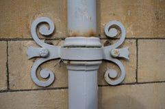 Ornamental cast iron downpipe Royalty Free Stock Photo