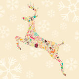 Ornamental Christmas reindeer with snowflakes Stock Photography