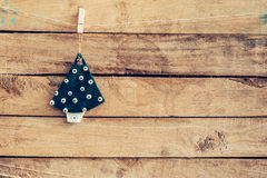 Ornamental christmas tree hanging on wooden for christmas backgr Stock Image