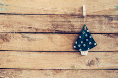 Ornamental christmas tree hanging on wooden for christmas backgr Royalty Free Stock Photography