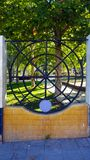 Ornamental circular metal railings in a park wall royalty free stock photo