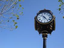 Ornamental city clock. City clock in Unirii Square in Bucharest Stock Photo