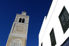 Ornamental city tower and blue sky in Sidi Bou Said,Tunisia Royalty Free Stock Images