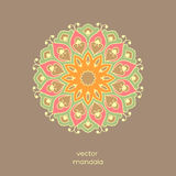Ornamental colorful floral mandala on light brown color backgrou Royalty Free Stock Photos