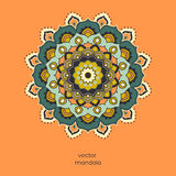 Ornamental colorful floral mandala on orange color background. Royalty Free Stock Image
