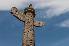 Ornamental column. An ornamental column with intricate carvings against the blue sky Stock Photos