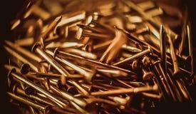 Ornamental copper nails Stock Photos