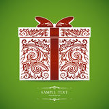 Ornamental decorative gift box. Ornamental red and white gift box on green background. Celebratory background with place for text. Vector illustration Royalty Free Stock Image
