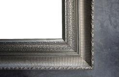 Ornamental detail silver color frame on concrete wall Stock Photo