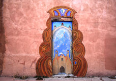 An ornamental Door in New Mexico. Painted doorway on an old adobe-style building in New Mexico Royalty Free Stock Photos