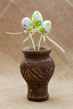 Ornamental easter eggs in a clay vase Royalty Free Stock Photos