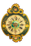 Ornamental eighteenth century wooden clock with flower pattern Stock Photos