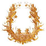 Ornamental Element in gold on isolated white. Royalty Free Stock Image