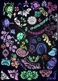 Ornamental elements set on black Royalty Free Stock Photos