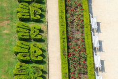 Ornamental English garden with white benches. (aerial view Royalty Free Stock Photo
