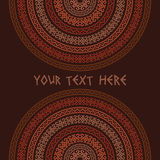 Ornamental ethnic colorful textures on dark brown background Stock Image
