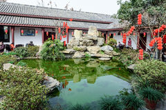 With ornamental fish pond teahouse courtyard. Royalty Free Stock Photography