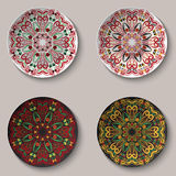 Ornamental floral mandala in boho style hohloma deposited on the souvenir ceramic plate. Set decorative design elements in black a Royalty Free Stock Photo