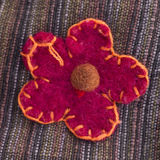 Ornamental flower stitched onto fabric Stock Photos